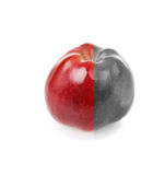 Fresh apple with red and decolourized half. Fresh apple with contrast red and green half Royalty Free Stock Image