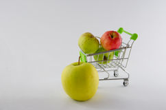 Fresh apple in the shopping cart. Fruit photo. Healthy product. Stock Photography