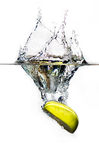 Fresh apple splashing to water. A fresh green apple is falling into clean water Royalty Free Stock Photos