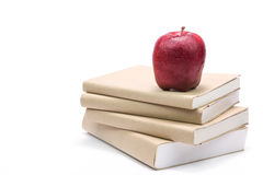 Fresh apple on stack of old books Royalty Free Stock Image