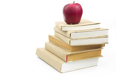 Fresh apple on stack of old books Royalty Free Stock Photos