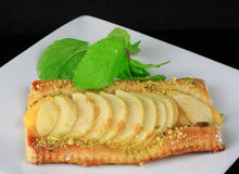 Fresh apple tart with leaves of mint on a dish Royalty Free Stock Photos
