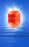 Fresh apple in water Royalty Free Stock Photos