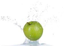 Fresh apple in water splash on white backround Stock Photography