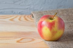 Fresh apple on a wooden table royalty free stock photos