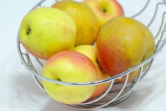 Fresh apples. A lot of apples i a basket royalty free stock photography