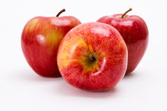 Fresh apples. Three, appetizing apples isolated on white background Stock Photography