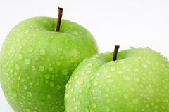 Fresh apples. Two green apples on white, selective focus Stock Image