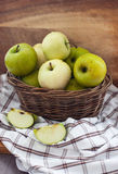 Fresh apples in basket on table Royalty Free Stock Photos