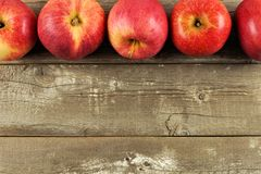 Fresh apples border on rustic aged wood Stock Photos