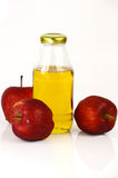 Fresh apples and a bottle of apple cider vinegar. Stock Image