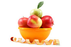 Fresh apples in a bowl and measuring tape. Stock Photography