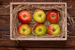 Fresh apples in box on wooden table close-up Royalty Free Stock Photos