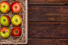 Fresh apples in box on wooden table with copy space Stock Image