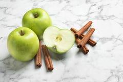 Fresh apples and cinnamon sticks Royalty Free Stock Photos