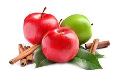 Fresh apples and cinnamon sticks. On white background Stock Image