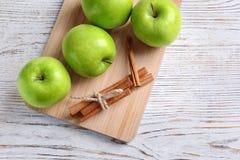 Fresh apples and cinnamon sticks Stock Photos