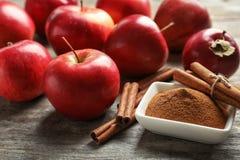 Fresh apples with cinnamon sticks and powder Stock Image