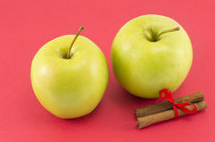 Fresh apples and cinnamon sticks with a ribbon Stock Photography