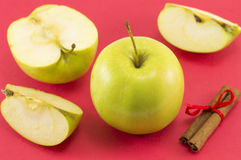 Fresh apples and cinnamon sticks with a ribbon Royalty Free Stock Photos