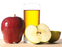 Fresh apples and glass of juice Royalty Free Stock Photography