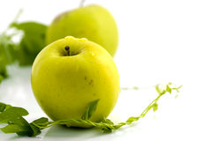 Fresh apples and green leaves Stock Photo