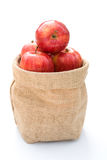 Fresh apples in gunny bag Royalty Free Stock Photography