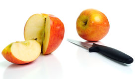 Fresh apples and a knife. Stock Photo