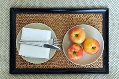 Fresh apples on laid table Royalty Free Stock Images