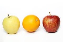Fresh apples and orange Royalty Free Stock Photo
