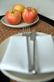 Fresh apples at place setting Royalty Free Stock Images