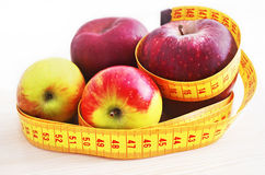 Fresh apples with tape measure - diet concept Royalty Free Stock Image