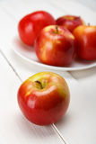 Fresh apples on a white wooden table stock photos