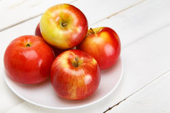 Fresh apples on a white wooden table stock image