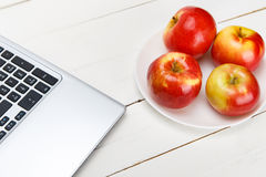 Fresh apples on a white wooden table royalty free stock photo