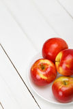 Fresh apples on a white wooden table stock photo