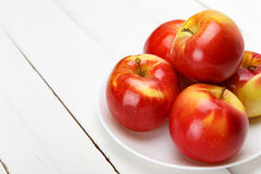Fresh apples on a white wooden table stock images