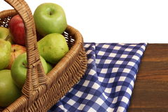 Fresh Apples In The Wicker Basket On Rustic Wood Table. Fresh Apples In The Wicker Basket On The Rustic Rough Brown Wood Table With Blue Checkered Tablecloth stock photography