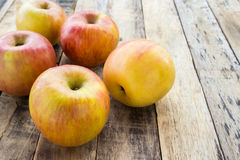 Fresh apples on wooden background Royalty Free Stock Photo