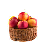 Fresh Apples in a wooden basket Stock Images