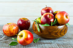Fresh apples in the wooden bowl Royalty Free Stock Photo