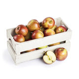 Fresh apples in a wooden crate Stock Images