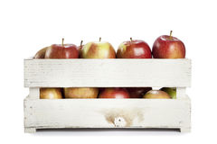 Fresh apples in a wooden crate. On white background Royalty Free Stock Image