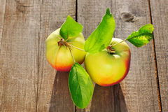 Fresh apples on wooden table Stock Photo