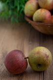 Fresh apples on a wooden table Stock Photography