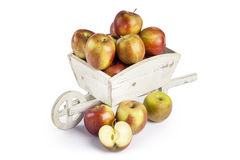 Fresh apples in a wooden wheelbarrow Stock Photo