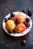 Fresh apricot and cherry Stock Photo