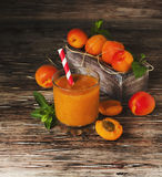 Fresh apricot juice in glass on wooden table, selective focus Royalty Free Stock Image