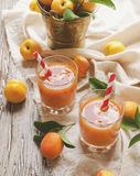 Fresh apricot juice in glass on wooden table, selective focus Stock Images