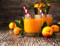 Fresh apricot juice in glass on wooden table, selective focus Stock Photography